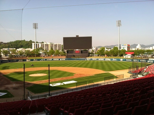 photo taken from stands of baseball stadium, overlooking field