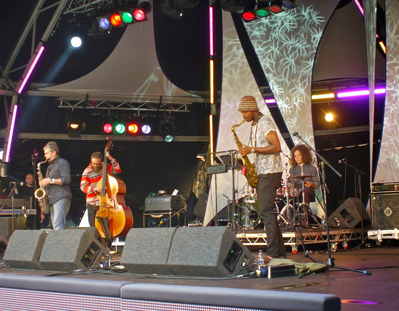 Seb Rochford and Polar Bear work up a storm of sound during the 2014 Canary Wharf Jazz Festival, Canada Square gardens, London E14