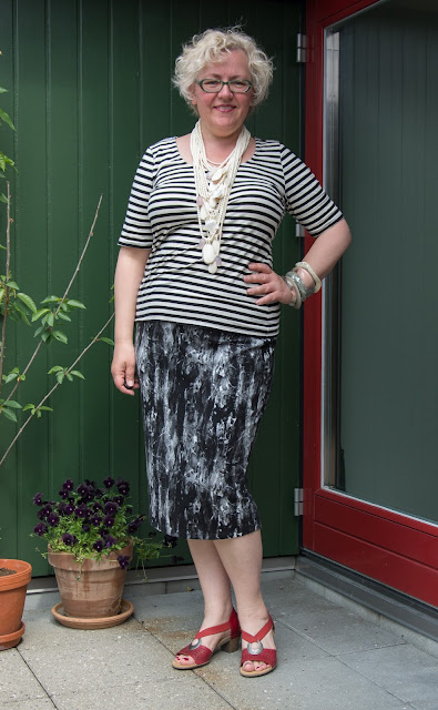 Kaffesoester in jersey skirt and t shirt with new Monies necklace