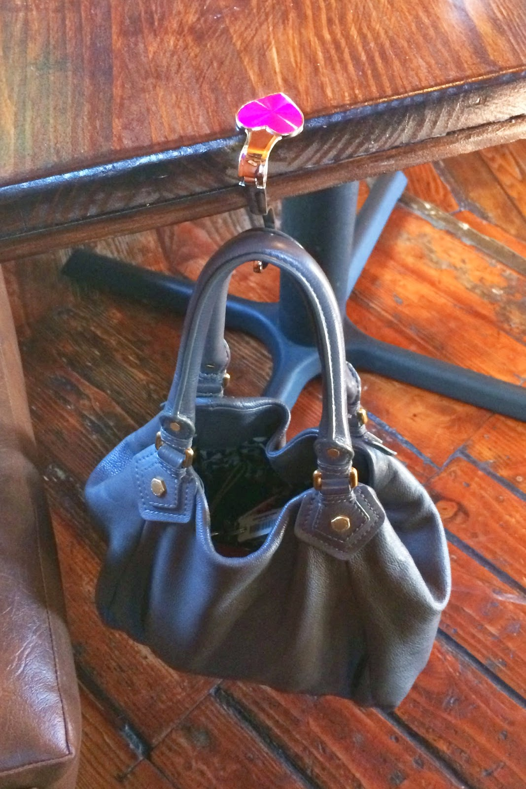 My Bag Pal hanging from a Saddle Ranch table - Hello Handbag