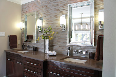 chic and eclectic bathroom vanity with minimalist counters and silver accent furnishings