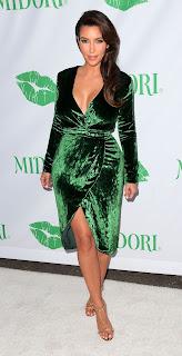 Kim Kardashian leggy in a green dress