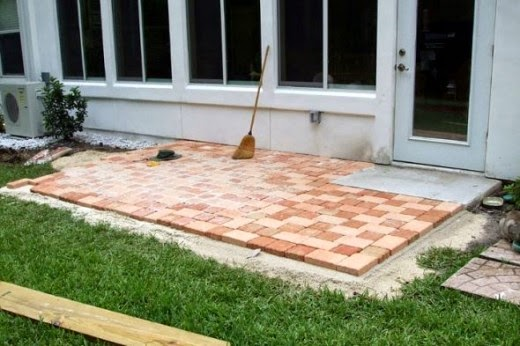 finishing the stone pattern placement for how to create a patio with stone pavers