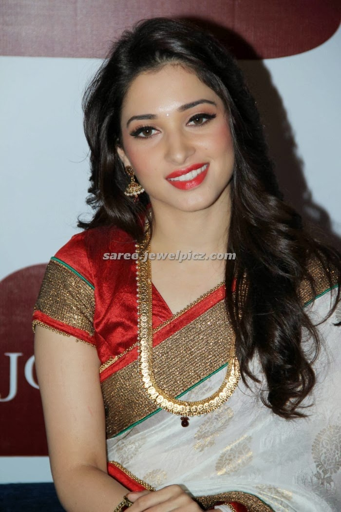 Tamanna in white designer bridal silk saree with red and green simple