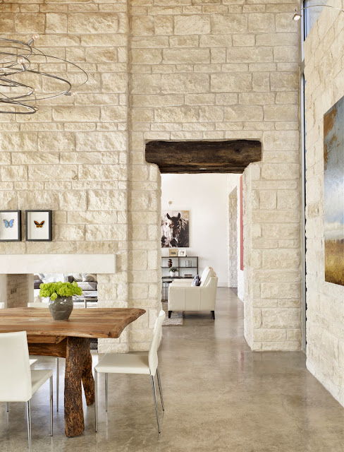 natural wood furniture, exposed white brick makes an elegant and soothing dining area