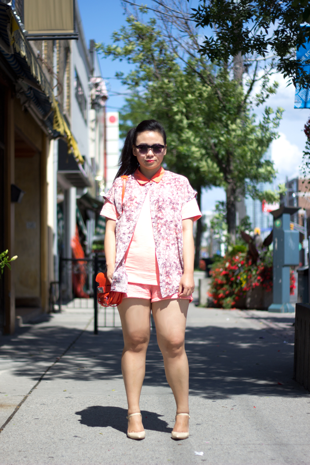 monochromatic-summer-look, neon-orange, floral-blouse, nude-pumps