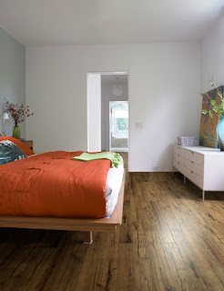 Cork flooring in bedroom with orange large bed
