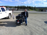 Dewey standing beside my bike