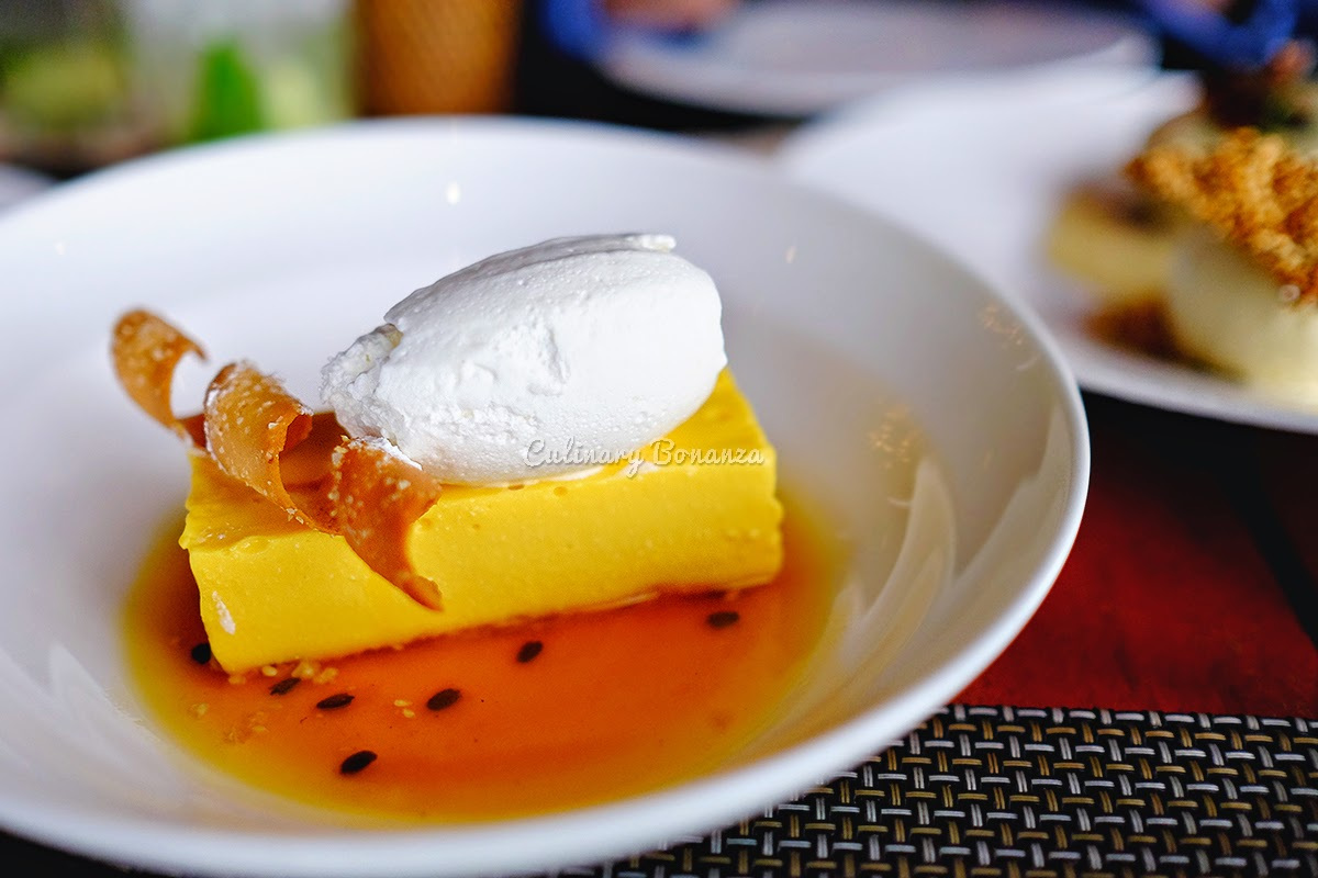 Mango Cheesecake with coconut whipped cream, passion fruit sauce, coconut tuile