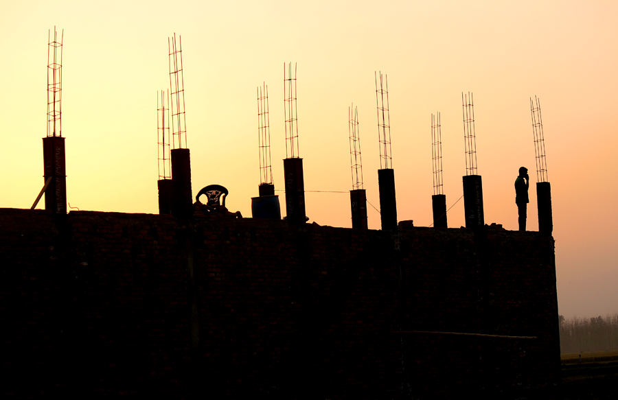 silhouette of construction with sunset in the background