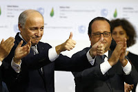 French President Francois Hollande, right, and French Foreign Minister and president of the COP21 Laurent Fabius react after the final conference at the COP21, the United Nations conference on climate change, in Le Bourget, north of Paris, Saturday, Dec.12, 2015. Governments have adopted a global agreement that for the first time asks all countries to reduce or rein in their greenhouse gas emissions. (Credit: AP Photo/Francois Mori) Click to Enlarge.