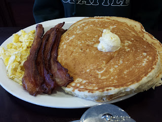 Hungry Man breakfast: shortstack, four pieces bacon, scrambled eggs.