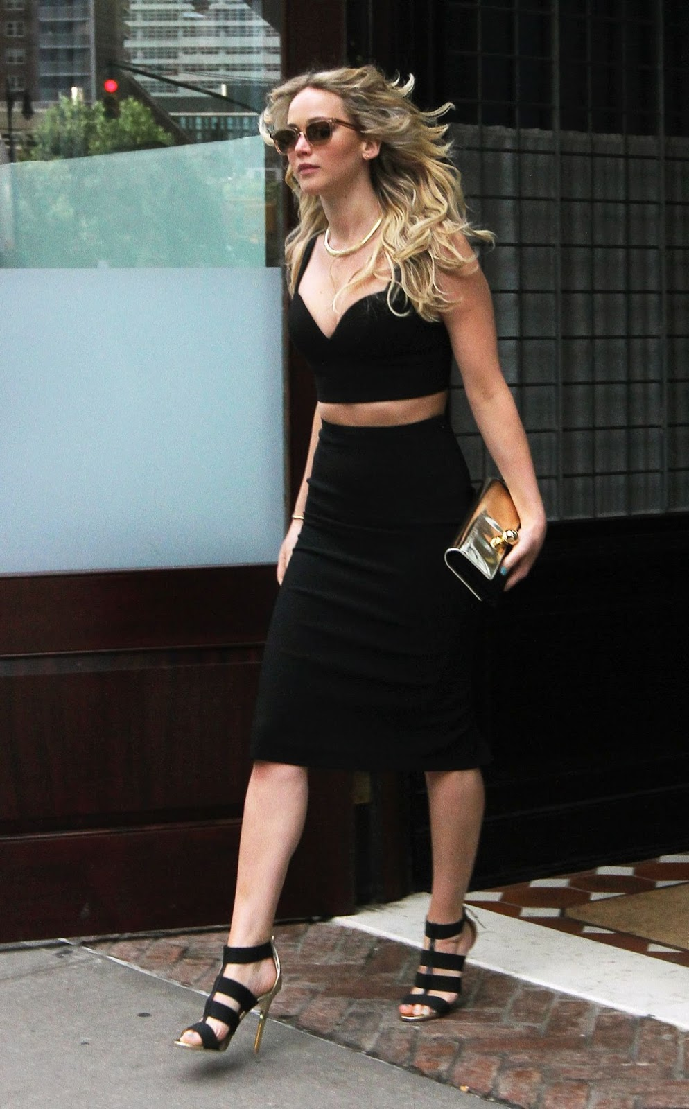 Jennifer Lawrence in a plunging cropped top and skirt in NYC