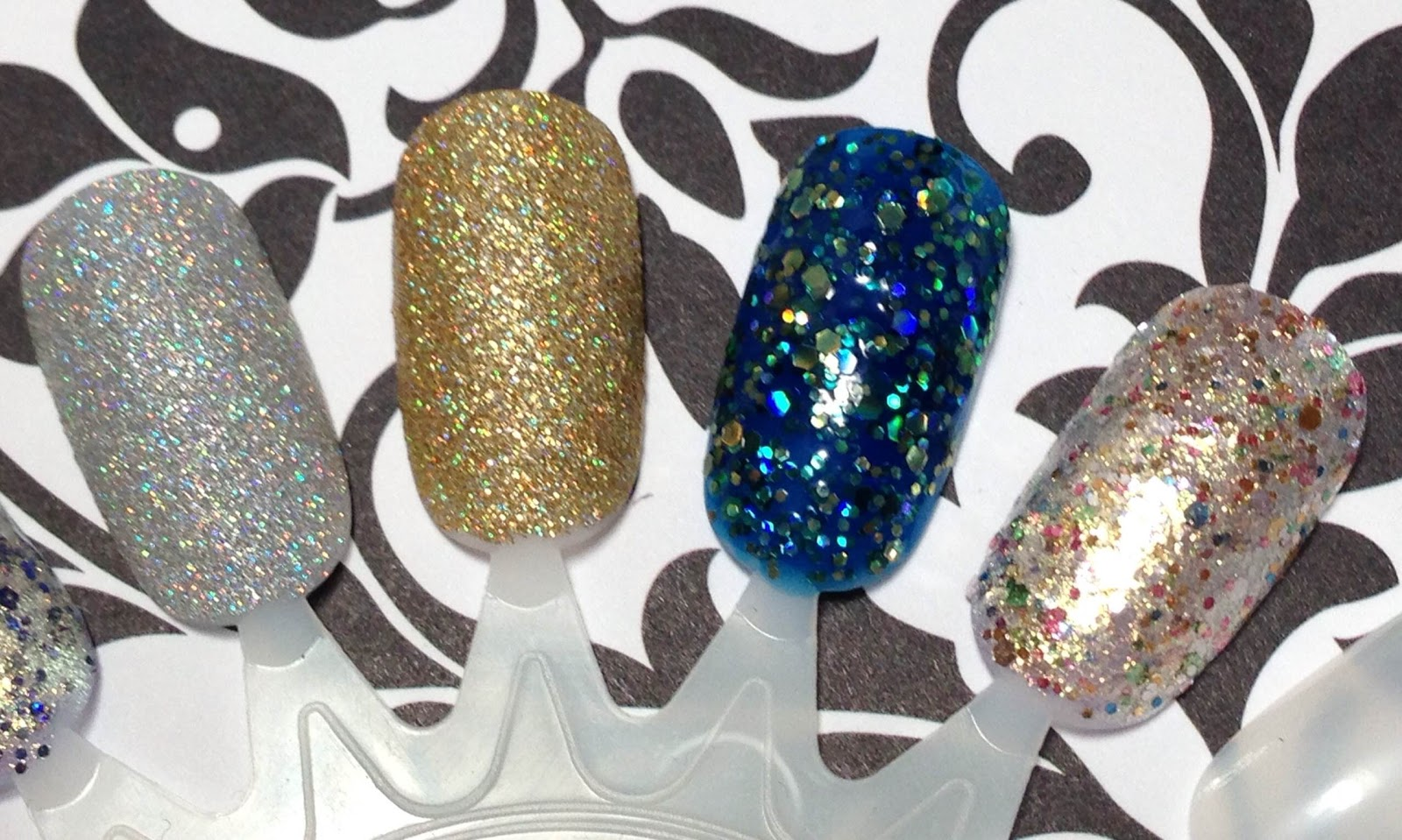 China Glaze Glistening Snow, China Glaze Angel Wings, Formula X Outburst, Formula X Light My Fire