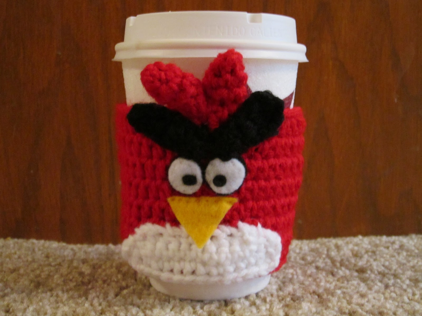 The crochet mommy angry birds coffee cozy crochet pattern red he just makes me happy i debuted by design for the angry red bird coffee cozy as part of a giveaway on my facebook page and he was so popular i bankloansurffo Images