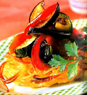 Nests made from baked spaghetti topped with mixed grilled vegetables.