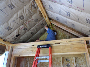 Tim is busy finishing up the insulation