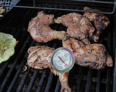 checking the temperature of grilled chicken