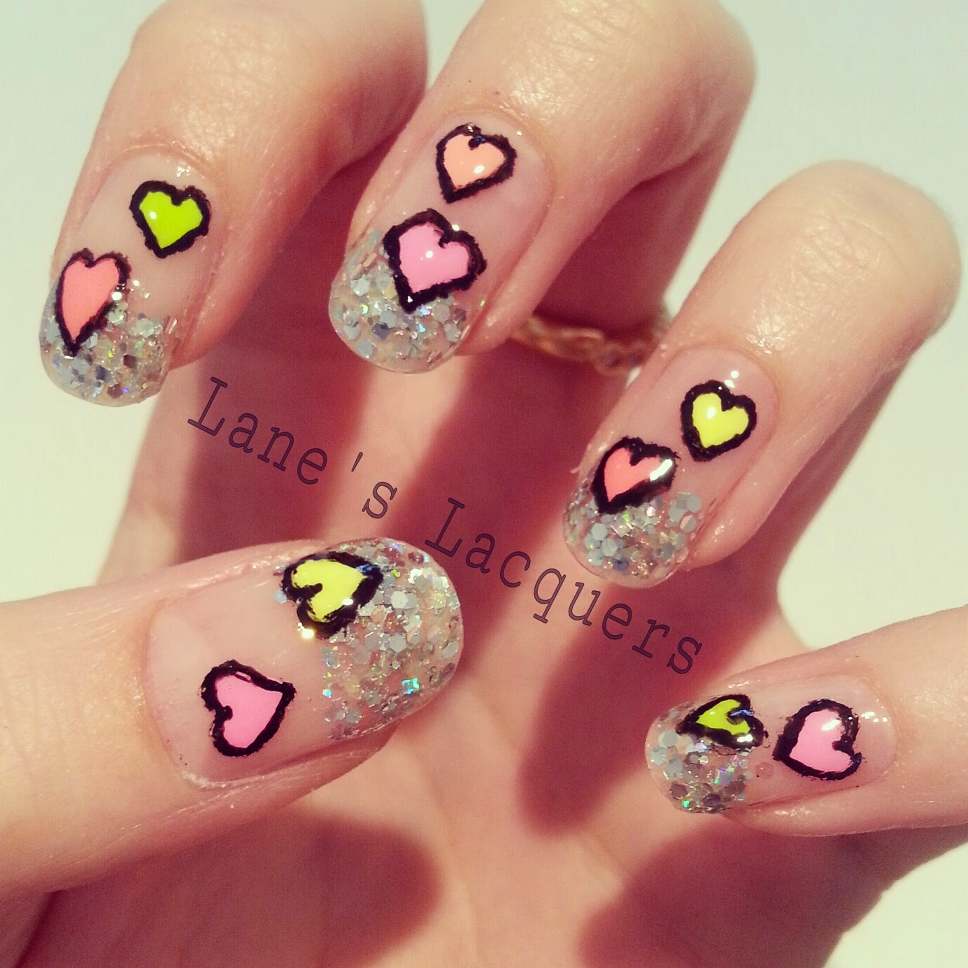 glitter-tips-neon-love-hearts-negative-space-nail-art