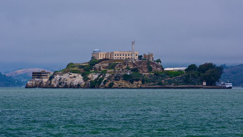 Alcatraz a small island in San Francisco Bay, Once it  was developed with facilities for a lighthouse, a military fortification, a military prison, and a federal prison.