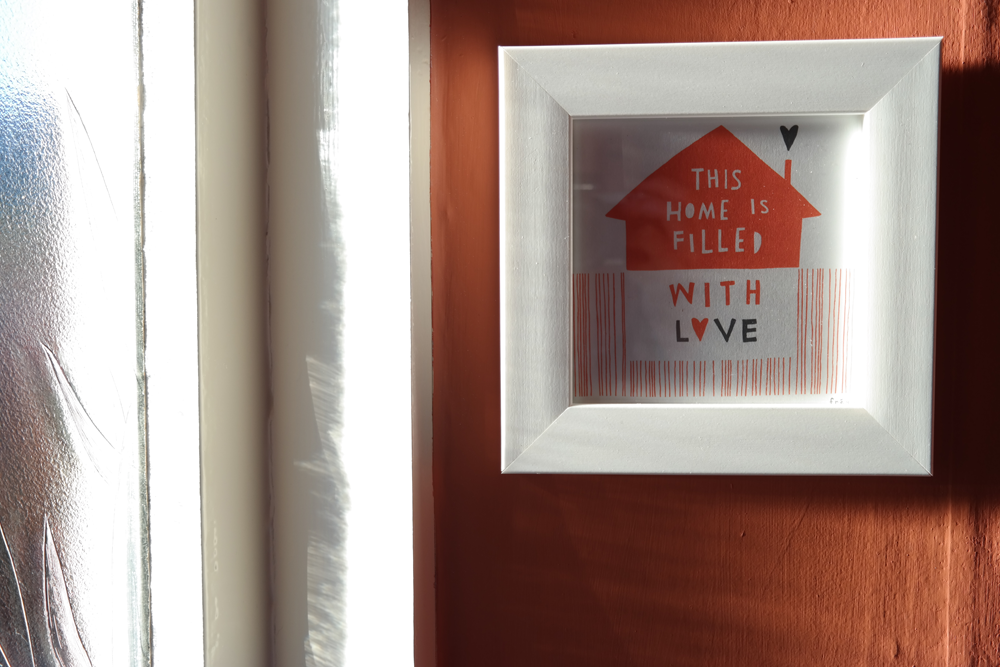 """This Home is Filled with Love"" print by Freya Art on Etsy. Not all bloggers live in pristine white palaces."