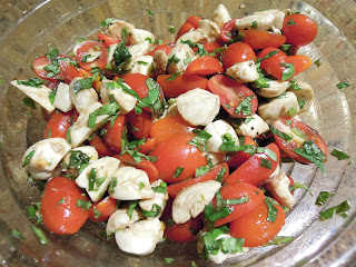 Caprese salad - tomatoes, fresh mozzarella cheese, basil, olive oil, and balsamic vinegar
