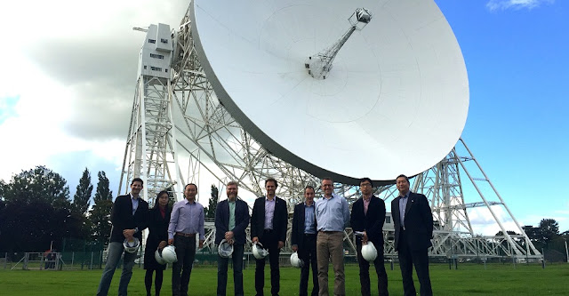 SKA Organisation hosted a Chinese media visit with Xinhua news agency, CCTV and Science & Technology Daily to announce the signature of the Letter of Intent. Posing here with Jodrell Bank's Lovell Telescope in the background. Credit: SKA