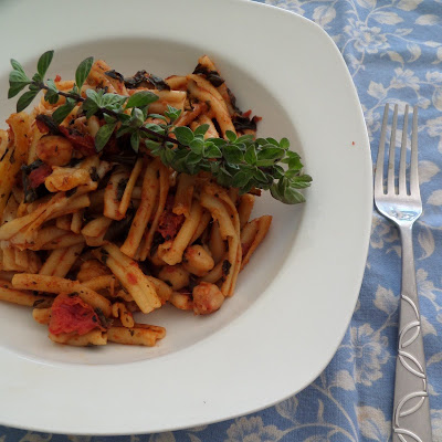 Spinach Pasta Bake:  A vegetarian one dish meal of pasta and tomato sauce, with spinach and garbanzo beans, baked with mozzarella.