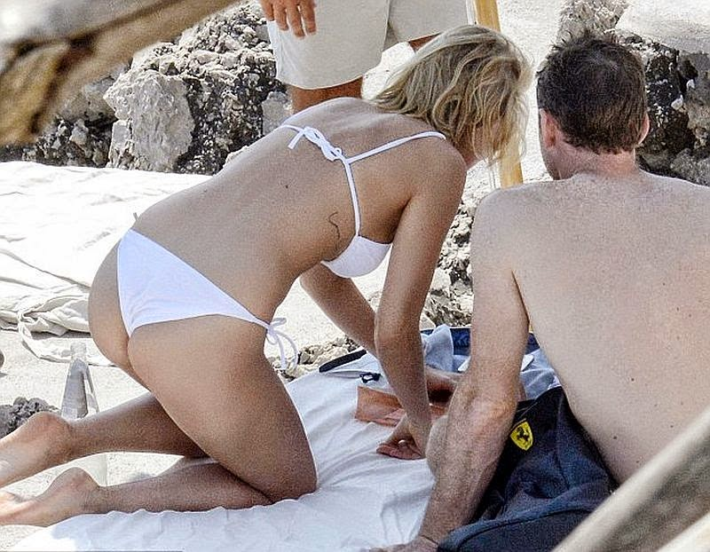 Winner or loser? the 26-year-old didn't wanted her bright day going deeply to loneliness as she drew people's attention in a white bikini adorned with the actor boyfriend, Sam Worthington in Capri, Italy on Wednesday, June 11, 2014.