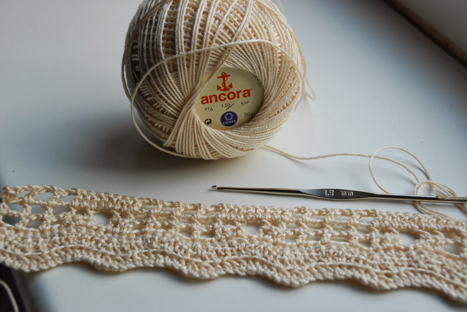 image of crochet cotton yarn with peek at current project