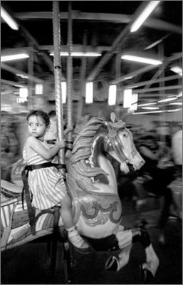 http://kvetchlandia.tumblr.com/post/112399490173/harold-feinstein-girl-on-the-merry-go-round