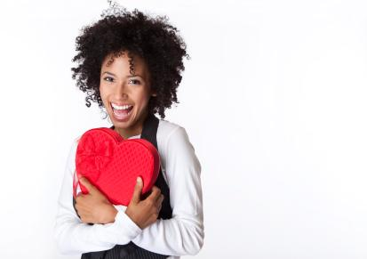 Valentines Day For Singles - single woman holding a red heart