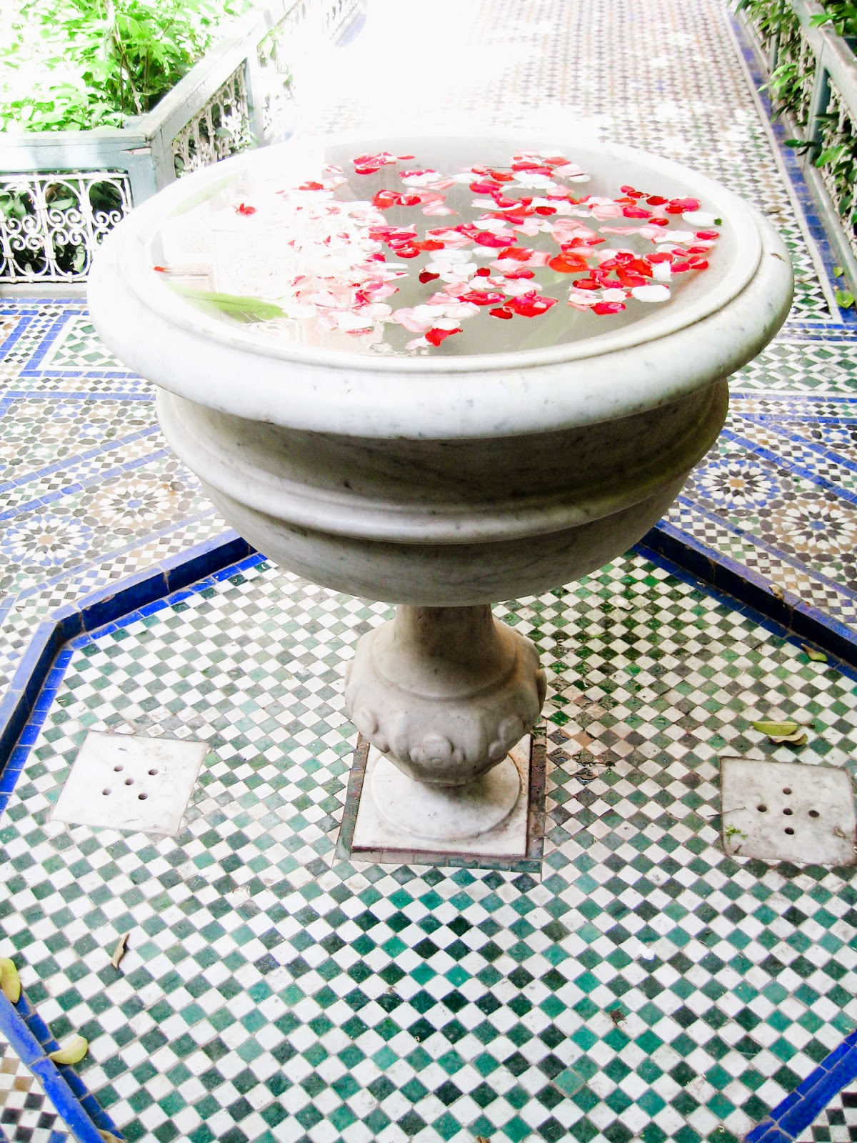Top Marrakech tourist attractions: Rose petals in traditional moroccan decor at Bahia Palace