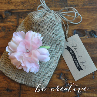 adding flowers to burlap bags on the Creative Bag blog