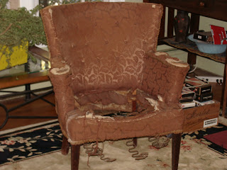 An old brown chair in need of repair.