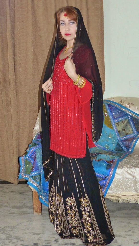 Indian party outfit: black lehenga and red kurta
