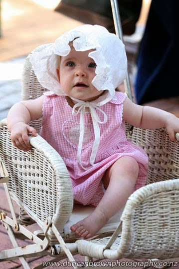 Never too young to be old-fashioned, a baby in a wicker pram photograph