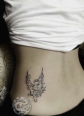 concise phoenix tattoo on the hip