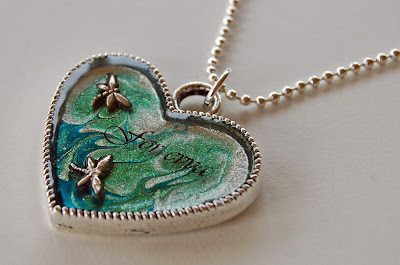 A nail polish necklace in green with dragonflies/dragonfly, a piece of nail polish jewellery/jewelry