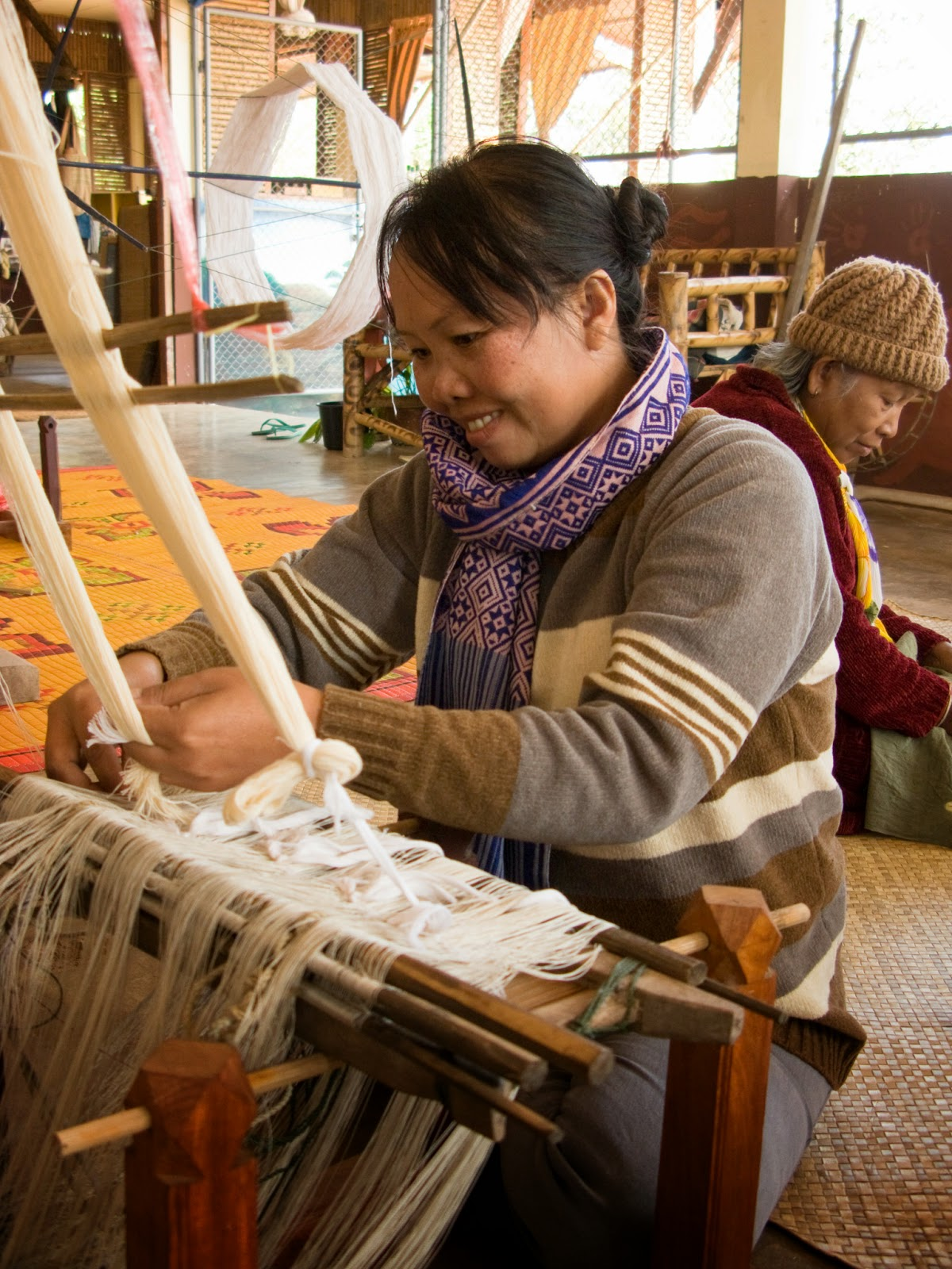 Cotton weavers, like silk weavers, usually work at home, but belonging to a weaving group allows Nuu Pun to receive training and other support.