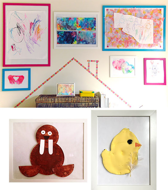 Colorful gallery wall with walrus and chick crafts.