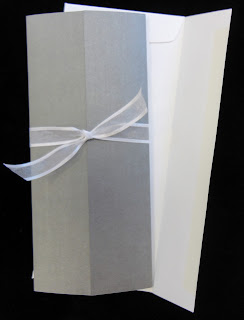 Elegant wedding invitations tied with a lovely ribbon