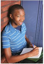 Smiling teenage doing homework near a school locker.