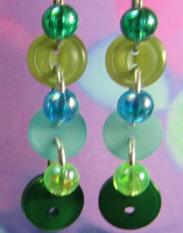 Drop dangle earrings have 3 buttons and 3 beads linked in long strand