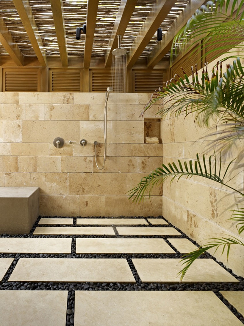 Modern shower with stone walls in the Gorgeous modern stone house on the beach