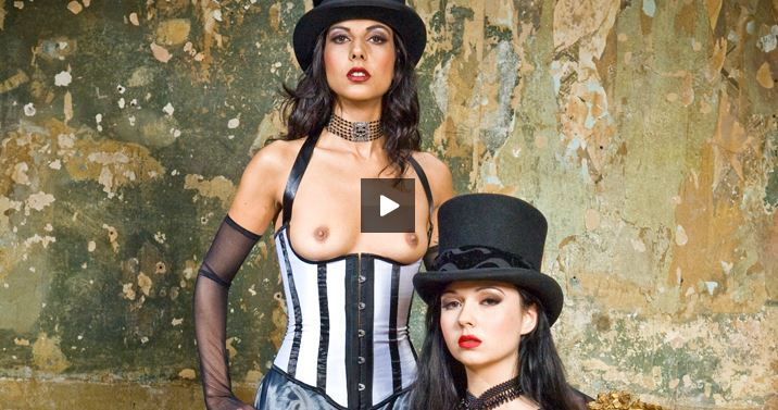 Horny sluts Angell Summers and Lou Charmelle masturbate in front of each other wearing corsets before being joined by a horny gentleman