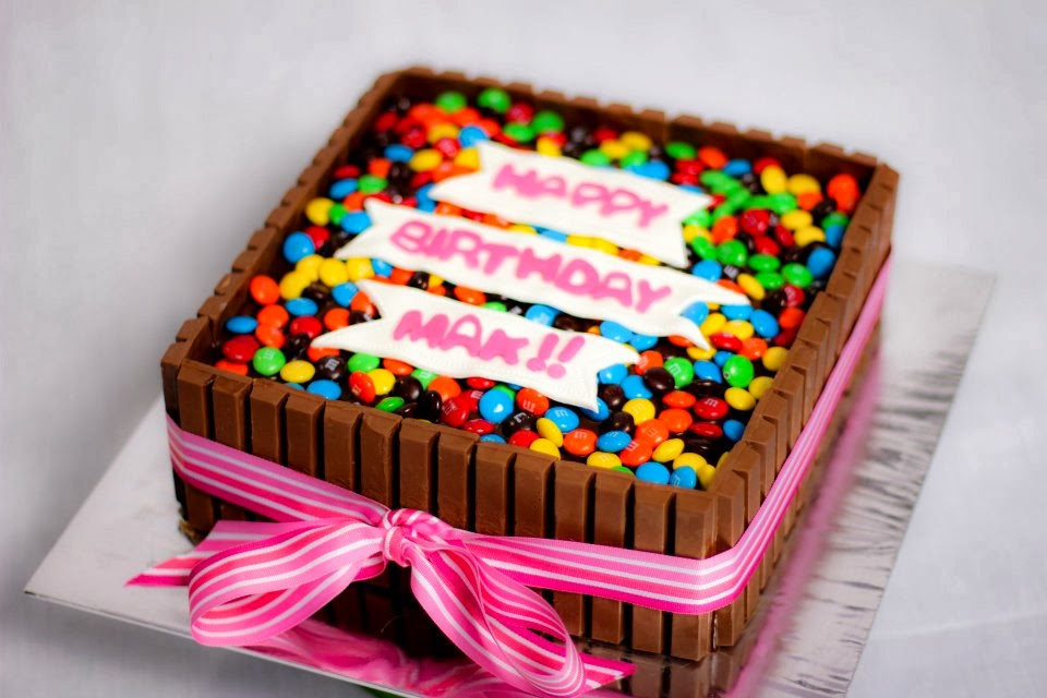 This is a square shaped cake using kitkats, I love the pink ribbon ...