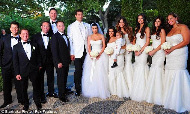 46a7929c73 Kim Kardashian and her bridesmaids wore stunning white Vera Wang dresses.  The bridesmaids wore matching strapless mermaid gowns that fit each lady ...