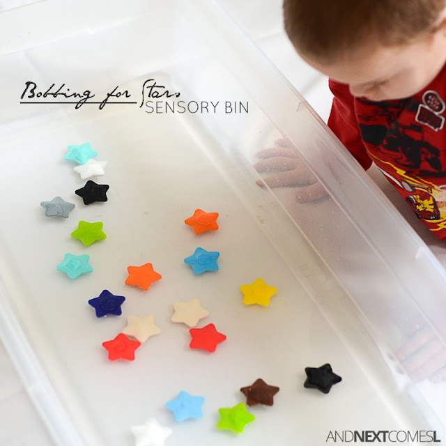 Bobbing for stars sensory bin for kids - a fun twist on the classic game of bobbing for apples from And Next Comes L