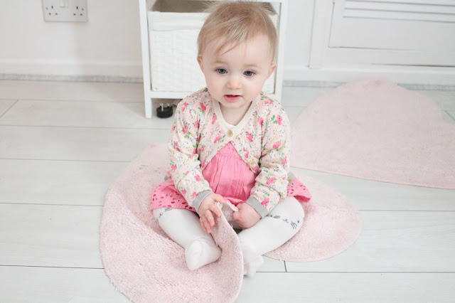 baby girl wearing pink next dress with next floral cardigan